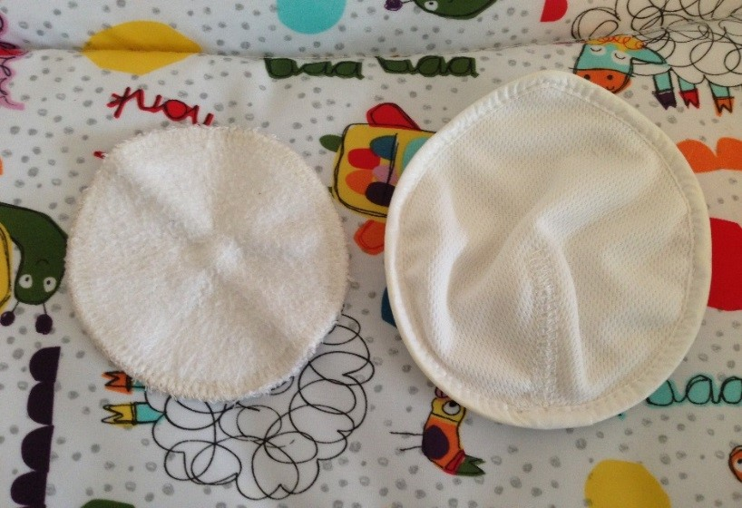 close breastpads next to other brand