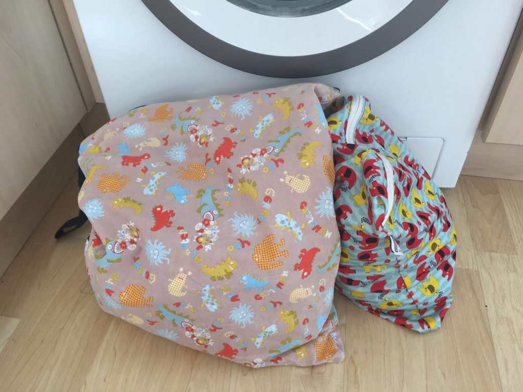 Wet bags full of cloth nappies, ready to wash