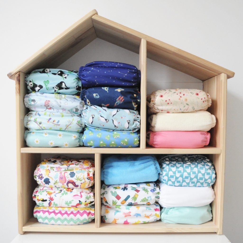 Real nappy week reusable cloth nappy collection in wooden house