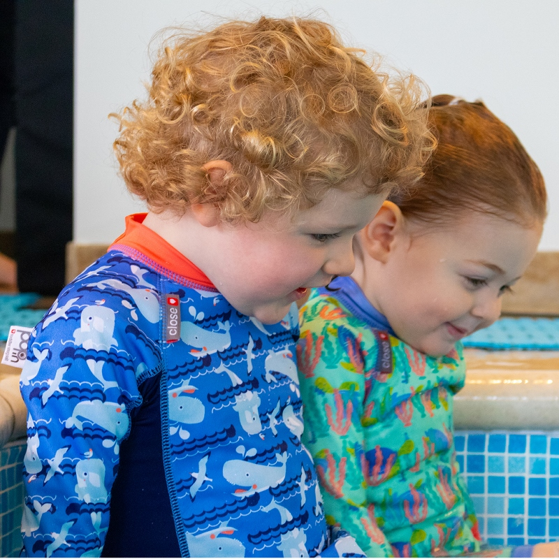 Two toddlers in Close pop-in swimwear