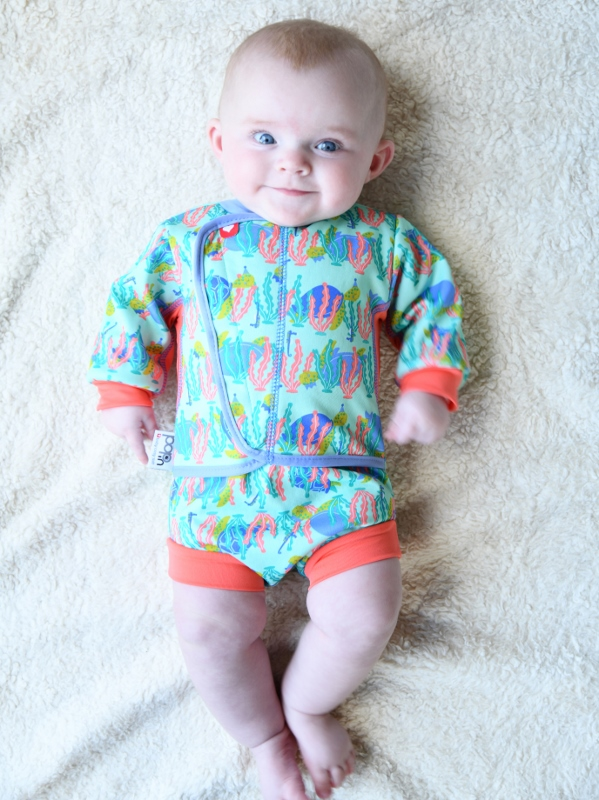 Baby wearing cosy suit swimwear