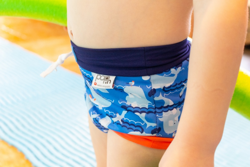 Toddler wearing swim nappy