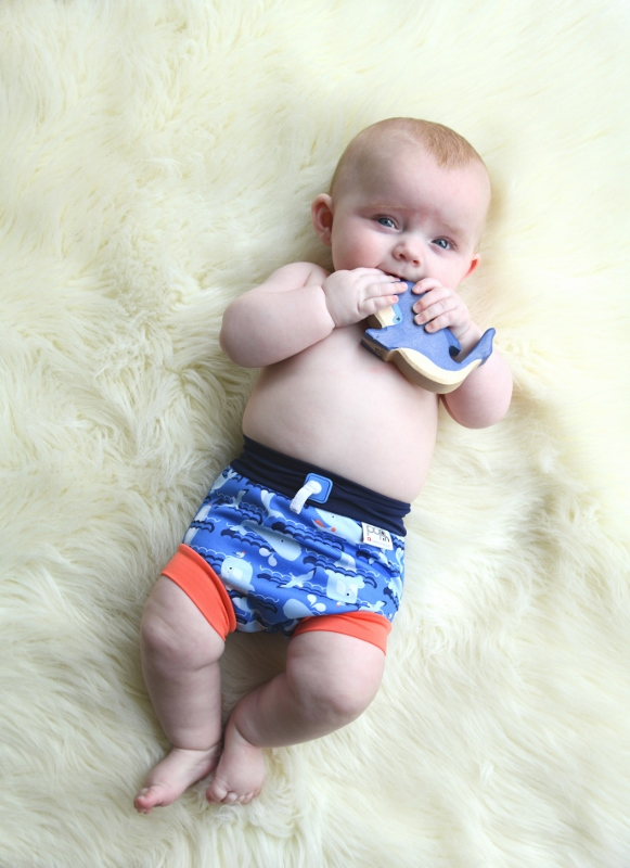 Baby wearing a reusable swim nappy