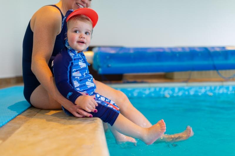 Toddler poolside in all-in-one swimwear