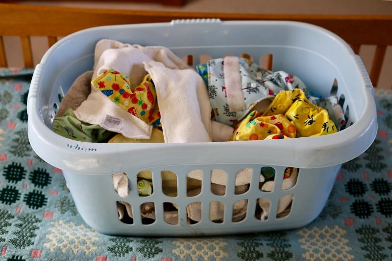 Washing basket full of cloth nappies