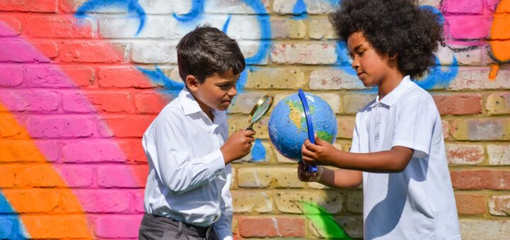 Children wearing Eco Outfitters polo shirt and trousers at school