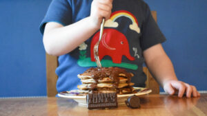 vegan pancakes topped with Tony's Chocolonely Fairtrade Chocolate