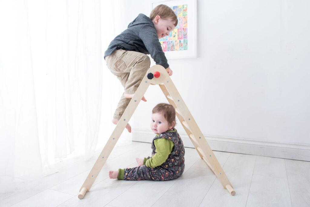 Children of all ages enjoy using a Pikler triangle