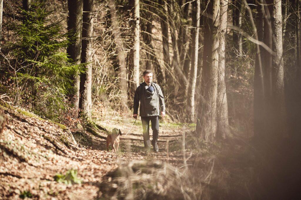 Babywearing dad walking through the woods