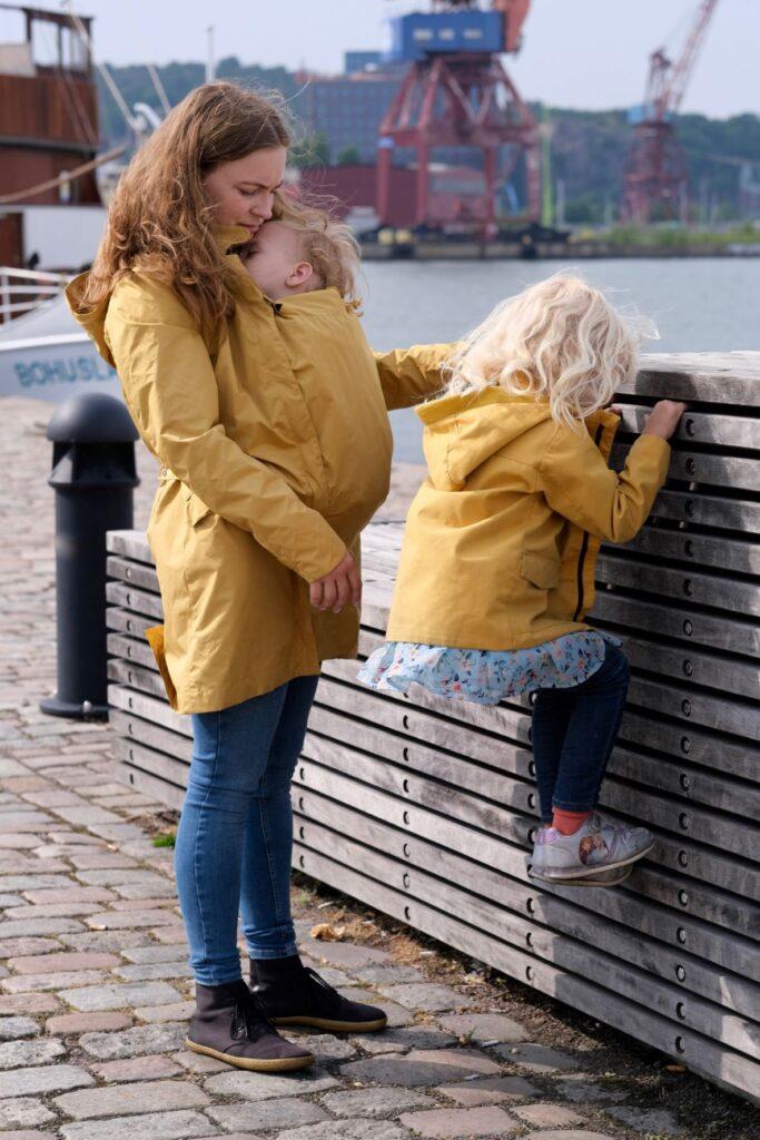 Mamalila Dublin Babywearing Rain Coat, babywearing mother and child